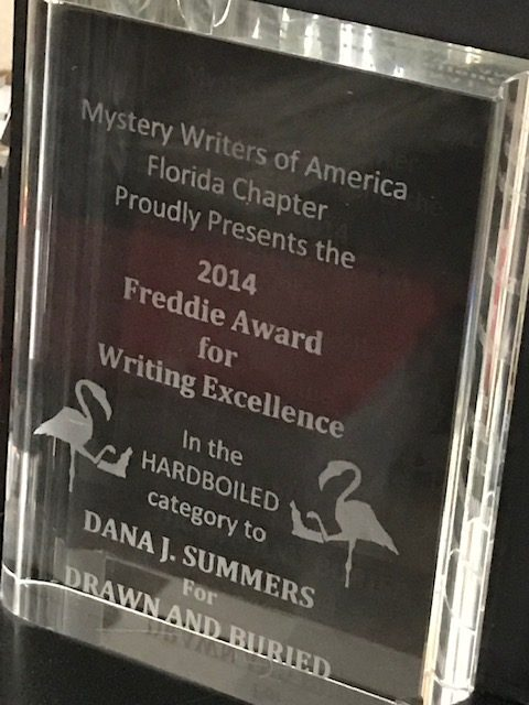 Mystery Writers of America 2014 Freddie Award for Writing Excellence in the Hardboiled category presented to Dana J Summers for Drawn and Buried