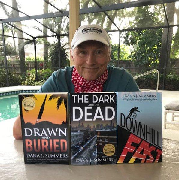 Dana with 3 books